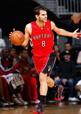 ATLANTA - DECEMBER 02:  Jose Calderon #8 of the Toronto Raptors against the Atlanta Hawks at Philips Arena on December 2, 2009 in Atlanta, Georgia.  NOTE TO USER: User expressly acknowledges and agrees that, by downloading and/or using this Photograph, Us