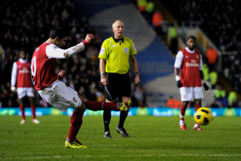 BIRMINGHAM, ENGLAND - JANUARY 01:  Robin Van Persie of Arsenal scores the opening goal of the match during the Barclays Premier Leaue match between Birmingham City and Arsenal at St. Andrews on January 1, 2011 in Birmingham, England.  (Photo by Michael Re