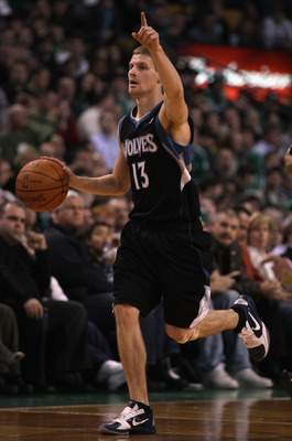 BOSTON, MA - JANUARY 03:  Luke Ridnour #13 of the Minnesota Timberwolves signals the play in the first half against the Boston Celtics on January 3, 2011 at the TD Garden in Boston, Massachusetts. NOTE TO USER: User expressly acknowledges and agrees that,