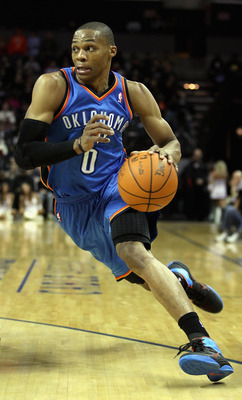 CHARLOTTE, NC - DECEMBER 21:  Russell Westbrook #0 of the Oklahoma City Thunder drives to the basket against the Charlotte Bobcats during their game at Time Warner Cable Arena on December 21, 2010 in Charlotte, North Carolina. NOTE TO USER: User expressly