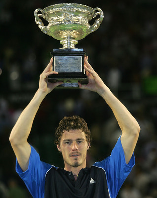 MELBOURNE, AUSTRALIA - JANUARY 30:  Marat Safin of Russia holds up the trophy after defeating Lleyton Hewitt of Australia during the Men's Final during day fourteen of the Australian Open Grand Slam at Melbourne Park January 30, 2005 in Melbourne, Austral