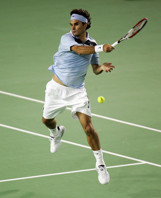 MELBOURNE, AUSTRALIA - JANUARY 28:  Roger Federer of Switzerland plays a forehand during his men's final match against Fernando Gonzalez of Chile on day fourteen of the Australian Open 2007 at Melbourne Park on January 28, 2007 in Melbourne, Australia.  (