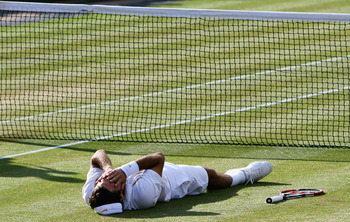 LONDON - JULY 08:  Roger Federer of Switzerland shows his emotions as he celebrates victory following the Men's Singles final match against Rafael Nadal of Spain during day thirteen of the Wimbledon Lawn Tennis Championships at the All England Lawn Tennis
