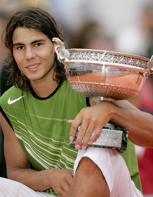 PARIS - JUNE 05:  Rafael Nadal of Spain poses with the winners trophy after his 3-1 sets victory over Mariano Puerta of Argentina during the Mens Final match during the fourteenth day of the French Open at Roland Garros on June 5, 2005 in Paris, France.