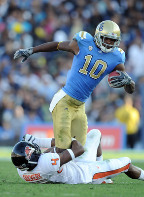 PASADENA, CA - NOVEMBER 06:  Akeem Ayers #10 of the UCLA Bruins is tackled by James Dockery #4 of the Oregon State Beavers during the first quarter at the Rose Bowl on November 6, 2010 in Pasadena, California.  (Photo by Harry How/Getty Images)