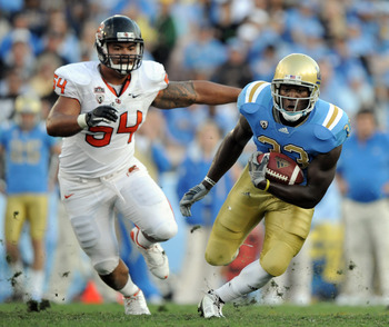 PASADENA, CA - NOVEMBER 06:  Derrick Coleman #33 of the UCLA Bruins runs from Stephen Paea #54 of the Oregon State Beavers at the Rose Bowl on November 6, 2010 in Pasadena, California.  (Photo by Harry How/Getty Images)