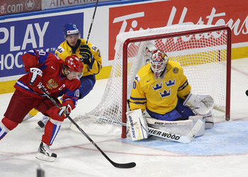 BUFFALO, NY - JANUARY 03: Vladimir Tarasenko #10 of Russia gets off a backhand shot against Robin Lehner #30 of Sweden  during the 2011 IIHF World U20 Championship Semi Final game between Sweden and Russia on January 3, 2011 in Buffalo, New York.  (Photo