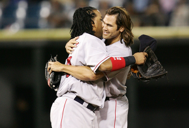 CHICAGO - JULY 21:  Johnny Damon #18 of the Boston Red Sox hugs teammate Manny Ramirez #24 after a win against the Chicago White Sox July 21, 2005 at U.S. Cellular Field in Chicago, Illinois. The Red Sox defeated the White Sox 6-5.  (Photo by Jonathan Dan