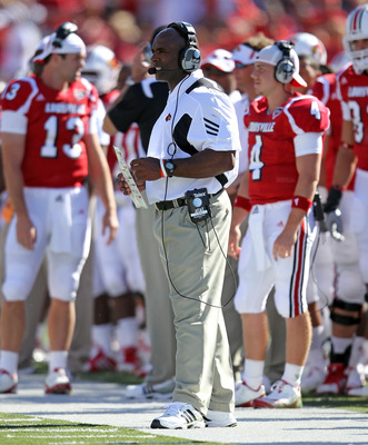 LOUISVILLE, KY - SEPTEMBER 04: Charlie Strong the Head Coach of the Louisville Cardinals gives instructions to his team during the game against the  Kentucky Wildcats at Papa John's Cardinal Stadium on September 4, 2010 in Louisville, Kentucky.  (Photo by