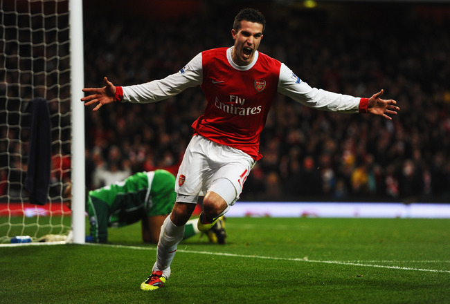 LONDON, UNITED KINGDOM - JANUARY 22:  Robin Van Persie of Arsenal celebrates scoring his third goal in a hat trick during the Barclays Premier League match between Arsenal and Wigan Athletic at the Emirates Stadium on January 22, 2011 in London, England.