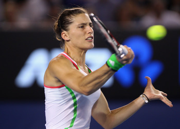 MELBOURNE, AUSTRALIA - JANUARY 21:  Andrea Petkovic of Germany plays a forehand in her third round match against Venus Williams of the United States of America during day five of the 2011 Australian Open at Melbourne Park on January 21, 2011 in Melbourne,