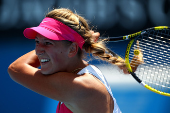 MELBOURNE, AUSTRALIA - JANUARY 21:  Victoria Azarenka of Belarus plays a forehand in her third round match against Channelle Scheepers of the Republic of South Africa during day five of the 2011 Australian Open at Melbourne Park on January 21, 2011 in Mel