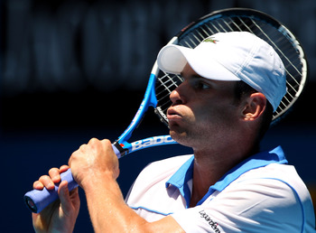 MELBOURNE, AUSTRALIA - JANUARY 21:  Andy Roddick of the United States of America plays a backhand in his third round match against Robin Haase of the Netherlands during day five of the 2011 Australian Open at Melbourne Park on January 21, 2011 in Melbourn