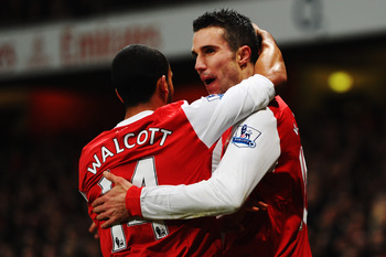Van Persie and Walcott celebrate
