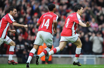 Fabregas, Walcott and Nasri celebrate