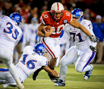LINCOLN, NE - NOVEMBER 13: Running back Roy Helu Jr. #10 of the Nebraska Cornhuskers weaves his way through the Kansas Jayhawk defense during second half action of their game at Memorial Stadium on November 13, 2010 in Lincoln, Nebraska. Nebraska Defeated