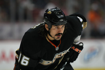 ANAHEIM, CA - JANUARY 02:  George Parros #16 of the Anaheim Ducks lines up in position on the wing for the faceoff during NHL game against the Chicago Blackhawks at Honda Center on January 2, 2011 in Anaheim, California. The Ducks defeated the Blackhawks