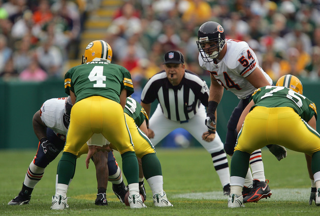 GREEN BAY, WI - SEPTEMBER 10:  Linebacker Brian Urlacher #54 of the Chicago Bears lines up at the line of scrimmage and watches quarterback Brett Favre #4 of the Green Bay Packers prior to the snap of the ball during their game on September 10, 2006 at La