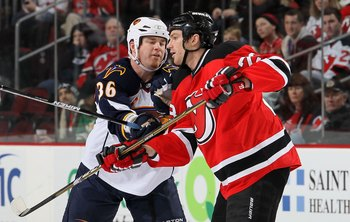 NEWARK, NJ - DECEMBER 31:  David Clarkson #23 of the New Jersey Devils skates against Eric Boulton #36 of the Atlanta Thrashers at the Prudential Center on December 31, 2010 in Newark, New Jersey.  (Photo by Jim McIsaac/Getty Images)