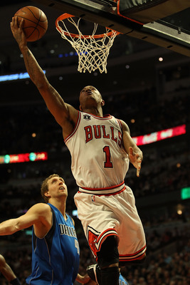 CHICAGO, IL - JANUARY 20: Derrick Rose #1 of the Chicago Bulls goes up for a shot past Dirk Nowitzki #41 of the Dallas Mavericks on his way to a game-high 26 points at the United Center on January 20, 2011 in Chicago, Illinois. The Bulls defeated the Mave