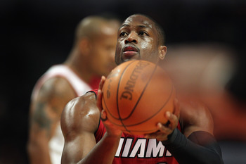 CHICAGO, IL - JANUARY 15:  Dwyane Wade #3 of the Miami Heat takes a free throw against the Chicago Bulls at the United Center on January 15, 2011 in Chicago, Illinois. The Bulls defeated the Heat 99-96. NOTE TO USER: User expressly acknowledges and agrees