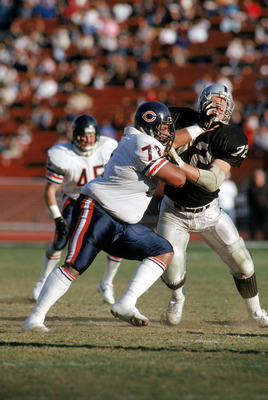 LOS ANGELES - DECEMBER 27:  Defensive tackle William Perry #72 of the Chicago Bears battles against center Don Mosebar #72 of the Los Angeles Raiders at the Los Angeles Memorial Coliseum on December 27, 1987 in Los Angeles, California.  The Bears won 6-3.