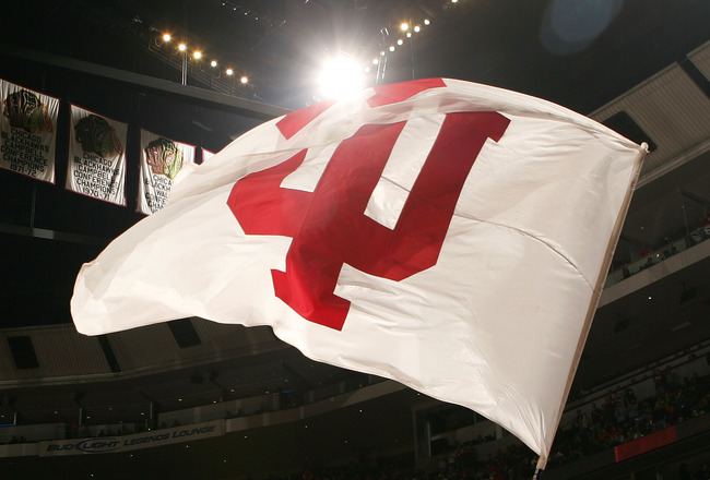 CHICAGO - MARCH 09:  A cheerleader from the Indiana Hoosiers waves a flag with Indiana's logo on the court against the Illinois Fighting Illini during the quarterfinals of the Big Ten Men's Basketball Conference Tournament March 9, 2007 at the United Cent