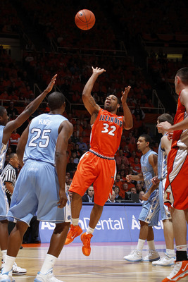 CHAMPAIGN, IL - NOVEMBER 30: Demetri McCamey #32 of the Illinois Fighting Illini puts up a shot in the lane against the North Carolina Tar Heels during the 2010 ACC/Big Ten Challenge at Assembly Hall on November 30, 2010 in Champaign, Illinois. Illinois d