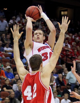 JACKSONVILLE, FL - MARCH 21:  Jon Leuer #30 of the Wisconsin Badgers shoots over Mark Coury #42 of the Cornell Big Red during the second round of the 2010 NCAA men's basketball tournament at Jacksonville Veteran's Memorial Arena on March 21, 2010 in Jacks