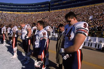 7 Nov 1999:  Shane Burton #94 of the Chicago Bears bows his head in observance of Walter Payton with his teammates before the game against the Green Bay Packers at Lambeau Field in Green Bay, Wisconsin. The Bears defeated the Packers 14-13. Mandatory Cred