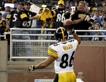 DETROIT , MI - OCTOBER 11:  Hines Ward #86 of the Pittsburgh Steelers celebrates a second quarter touchdown by throwing the ball to fans while playing the Detroit Lions on October 11, 2009 at Ford Field in Detroit, Michigan.  (Photo by Gregory Shamus/Gett