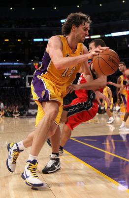 LOS ANGELES, CA - JANUARY 14:  Pau Gasol #16 of the Los Angeles Lakers shoots drives past Kris Humphries #43 of the New Jersey Nets at Staples Center on January 14, 2011 in Los Angeles, California. The Lakers won 100-88.  NOTE TO USER: User expressly ackn