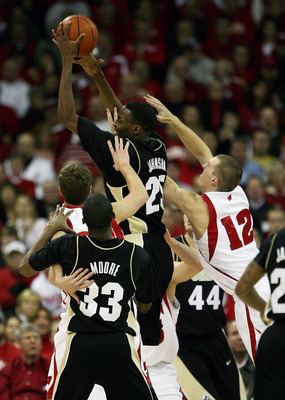 MADISON, WI - JANUARY 27: JaJuan Johnson #25 of the Purdue Boilermakers leaps to pull down a rebound against Jason Bohannon #12 of the Wisconsin Badgers at the Kohl Center January 27, 2009 in Madison, Wisconsin. (Photo by Jonathan Daniel/Getty Images)