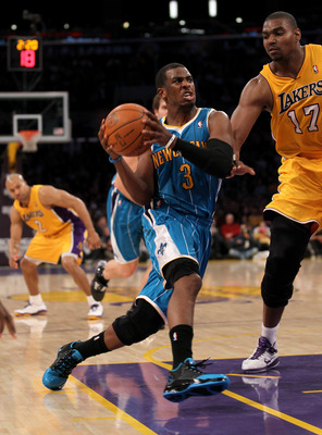 LOS ANGELES, CA - JANUARY 7:  Chris Paul #3 of the New Orleans Hornets drives against Andrew Bynum #17 of the Los Angeles Lakers at Staples Center on January 7, 2011 in Los Angeles, California.  NOTE TO USER: User expressly acknowledges and agrees that, b