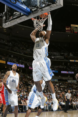 DENVER - APRIL 17:  Carmelo Anthony #15 of the Denver Nuggets shoots against the Houston Rockets on April 17, 2006 at the Pepsi Center in Denver, Colorado.  The Rockets won 86-83.  NOTE TO USER: USER expressly acknowledges and agrees that, by downloading