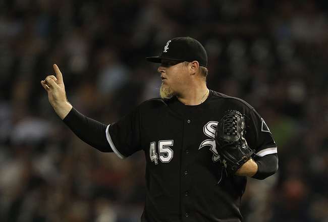 CHICAGO - AUGUST 10: Bobby Jenks #45 of the Chicago White Sox signals to teammates against the Minnesota Twins at U.S. Cellular Field on August 10, 2010 in Chicago, Illinois. The Twins defeated the White Sox 12-6. (Photo by Jonathan Daniel/Getty Images)