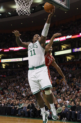 BOSTON, MA - JANUARY 10:  Glen Davis #11 of the Boston Celtics heads to the net as Shane Battier #31 of the Houston Rockets defends on January 10, 2011 at the TD Garden in Boston, Massachusetts.  NOTE TO USER: User expressly acknowledges and agrees that,