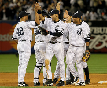 NEW YORK - OCTOBER 09:  (L-R) Mariano Rivera #42, Derek Jeter #2 and Robinson Cano #24 of the New York Yankees celebrate after their 6-1 win against the Minnesota Twins during Game Three of the ALDS part of the 2010 MLB Playoffs at Yankee Stadium on Octob