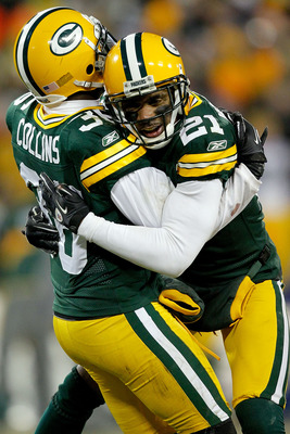 GREEN BAY, WI - JANUARY 02:  Nick Collins #36 of the Green Bay Packers is congratulated by Charles Woodson #21 after making an interception against the Chicago Bears to end their final drive in the fourth quarter at Lambeau Field on January 2, 2011 in Gre