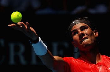MELBOURNE, AUSTRALIA - JANUARY 20:  Rafael Nadal of Spain serves in his second round match against Ryan Sweeting of the United States of America during day four of the 2011 Australian Open at Melbourne Park on January 20, 2011 in Melbourne, Australia.  (P