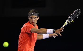 MELBOURNE, AUSTRALIA - JANUARY 22:  Rafael Nadal of Spain plays a forehand in his third round match against Bernard Tomic of Australia during day six of the 2011 Australian Open at Melbourne Park on January 22, 2011 in Melbourne, Australia.  (Photo by Jul