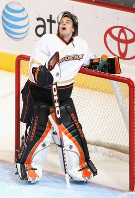 GLENDALE, AZ - JANUARY 15:  Goaltender Jonas Hiller #1 of the Anaheim Ducks looks up a the video board during the NHL game against the Phoenix Coyotes at Jobing.com Arena on January 15, 2011 in Glendale, Arizona.  (Photo by Christian Petersen/Getty Images