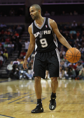 CHARLOTTE, NC - NOVEMBER 08:  Tony Parker #9 of the San Antonio Spurs against the Charlotte Bobcats during their game at Time Warner Cable Arena on November 8, 2010 in Charlotte, North Carolina.  NOTE TO USER: User expressly acknowledges and agrees that,