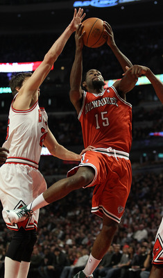 CHICAGO, IL - DECEMBER 28: John Salmons #15 of the Milwaukee Bucks drives to the basket past Kyle Korver #26 of the Chicago Bulls at the United Center on December 28, 2010 in Chicago, Illinois. NOTE TO USER: User expressly acknowledges and agrees that, by
