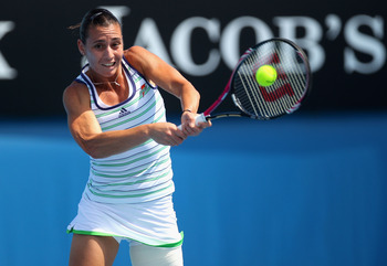 MELBOURNE, AUSTRALIA - JANUARY 20:  Flavia Pennetta of Italy plays a backhand in her second round match against Lourdes Dominguez Lino of Spain during day four of the 2011 Australian Open at Melbourne Park on January 20, 2011 in Melbourne, Australia.  (Ph