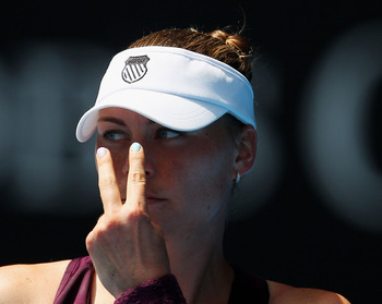 MELBOURNE, AUSTRALIA - JANUARY 22:  Vera Zvonareva of Russia points to her eyes in her third round match against Lucie Safarova of the Czech Republic during day six of the 2011 Australian Open at Melbourne Park on January 22, 2011 in Melbourne, Australia.