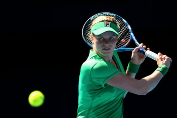 MELBOURNE, AUSTRALIA - JANUARY 22:  Kim Clijsters of Belgium plays a backhand in her third round match against Alize Cornet of France during day six of the 2011 Australian Open at Melbourne Park on January 22, 2011 in Melbourne, Australia.  (Photo by Ryan