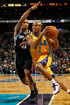 NEW ORLEANS, LA - JANUARY 22:  Jarrett Jack #2 of the New Orleans Hornets drives the ball around George Hill #3 of the San Antonio Spurs at the New Orleans Arena on January 22, 2011 in New Orleans, Louisiana.  The Hornets defeated the Spurs 96-72.  NOTE T