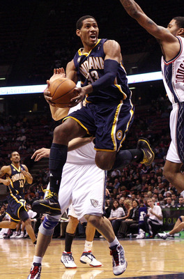 EAST RUTHERFORD, NJ - JANUARY 15:  Danny Granger #33 of the Indiana Pacers drives to the basket against the New Jersey Nets at the Izod Center on January 15, 2010 in East Rutherford, New Jersey. NOTE TO USER: User expressly acknowledges and agrees that, b