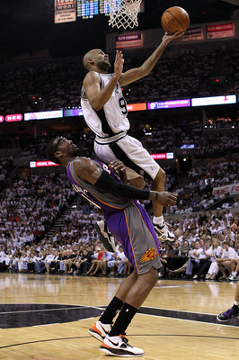 SAN ANTONIO - MAY 07:  Guard Tony Parker #9 of the San Antonio Spurs draws the foul by Amar'e Stoudemire #1 of the Phoenix Suns in Game Three of the Western Conference Semifinals during the 2010 NBA Playoffs at AT&T Center on May 7, 2010 in San Antonio, T